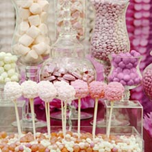 Cake pops and assorted candies in glass jars