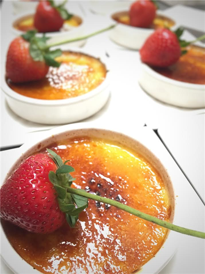 cremebrulee wih a strawberry on top