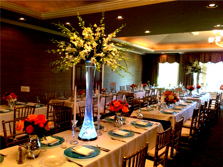 indoor wedding set up, large glowing flowers and blue plates