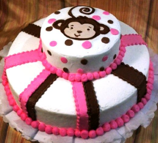 two layer round cake with a monkey on top