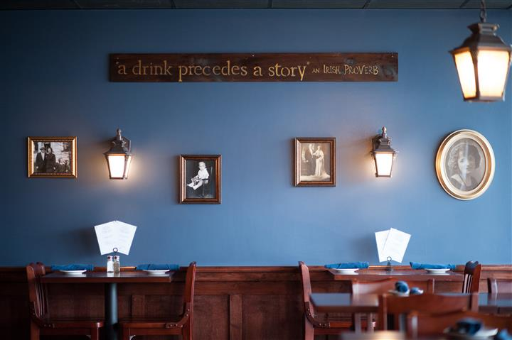 "Wall with sign that reads ""a drink precedes a story"""