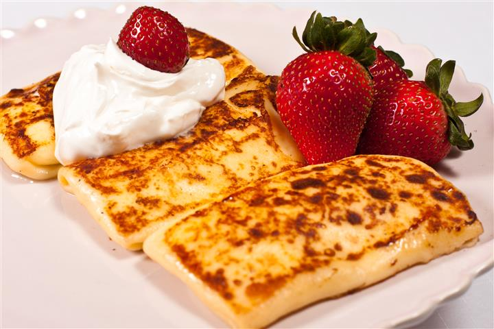 cheese blintzes with sour cream and strawberries