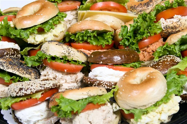 Assorted bagels with tomato, lettuce and tuna