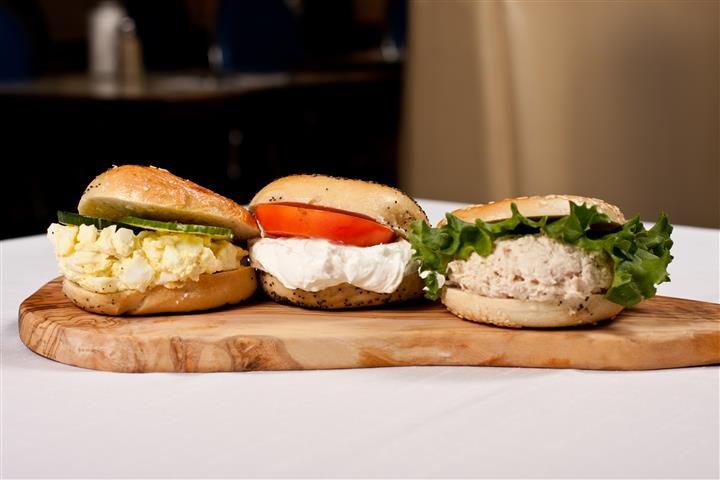 assorted egg and tuna sandwiches on carving board
