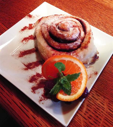 Cinnamon bun dessert with orange garnish