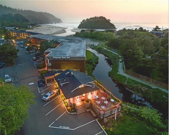 Above ground point of view of restaurant, parking lot and body of water