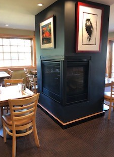 set-up table next to fire-place inside the dining area
