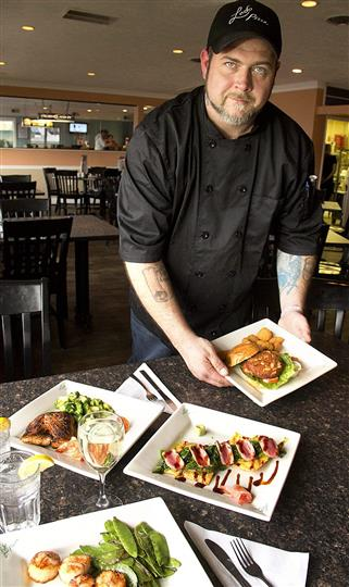 Chef preparing multiple platters of food