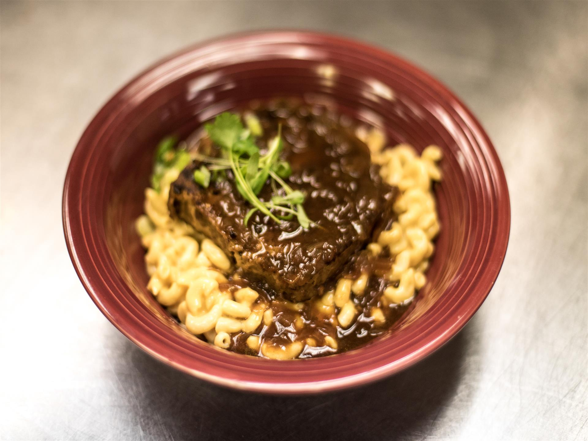 Buffalo Meatloaf Bowl served on our macaroni & cheese and topped with black onion gravy