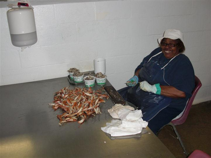 A Woman preparing crab legs