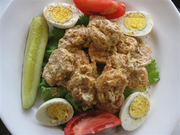 Boiled eggs with sliced pickle and tomatoes