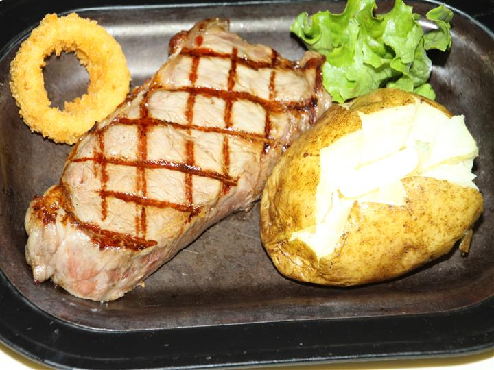 steak with a baked potato