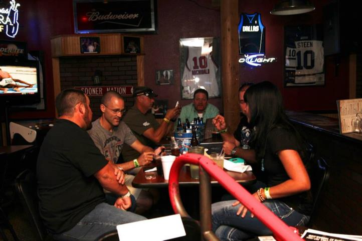 Group of people sitting at a table having a conversation.