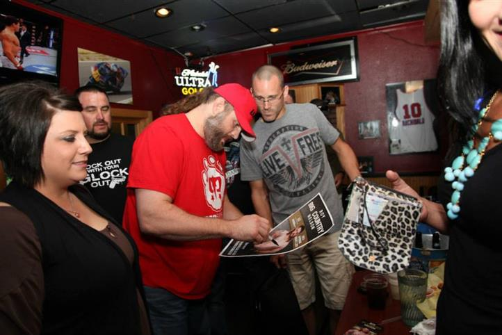 UFC event meet and greet signing a poster