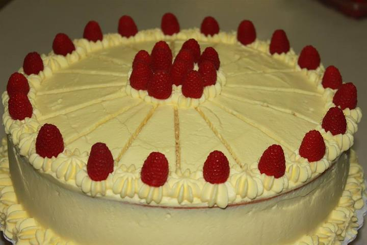 Cake topped with raspberries