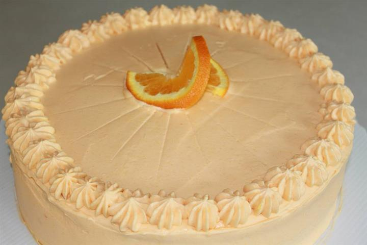 Cake topped with a orange slice