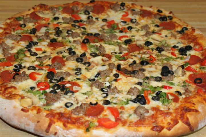 Pizza pie with multiple toppings