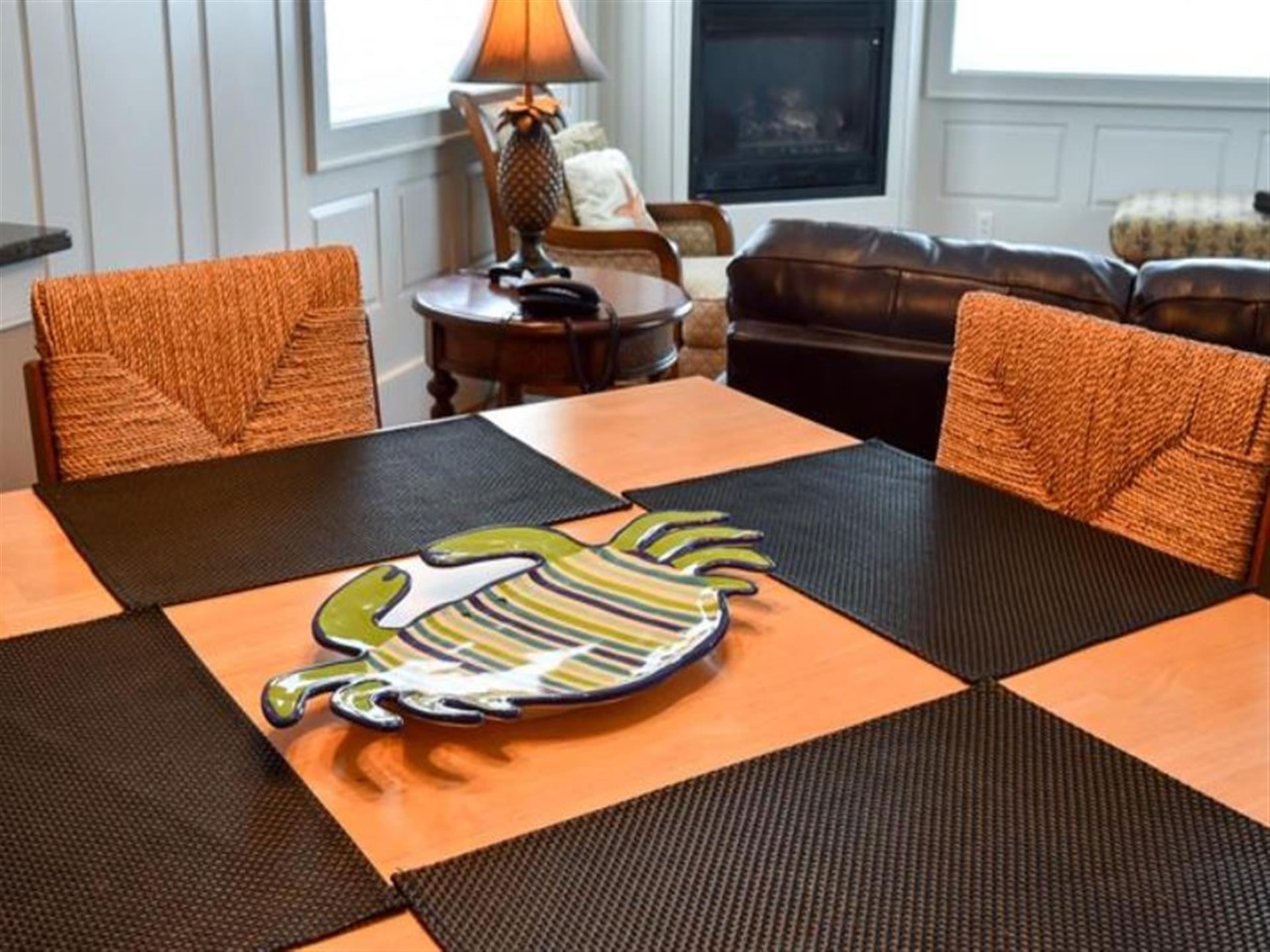 dining room table with a a crab plate on it