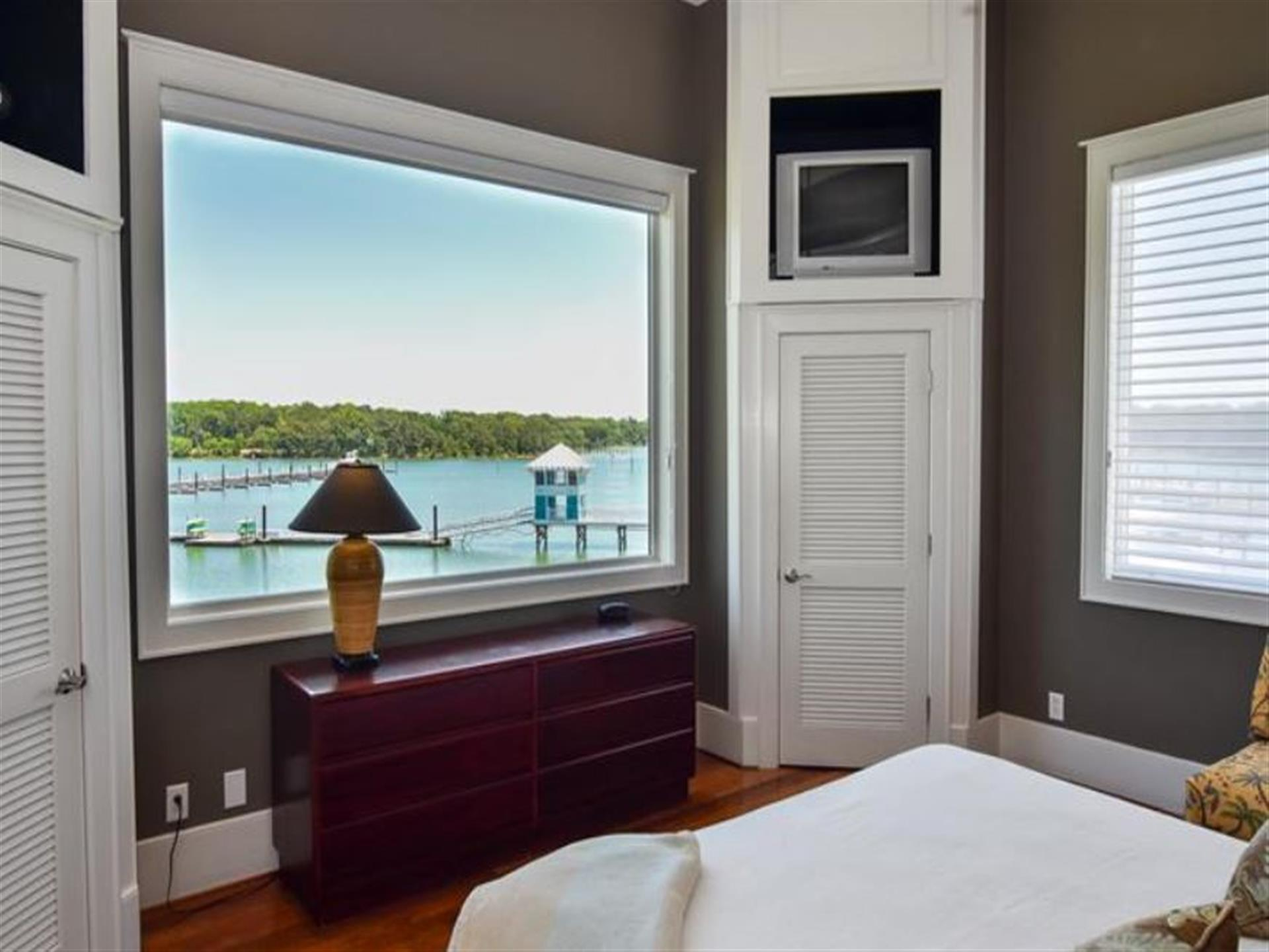 view of the bay from the bed of the bedroom