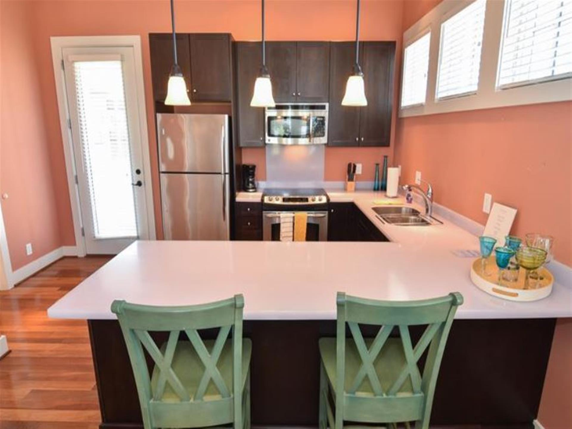 Kitchen with a breakfast counter and pink walls