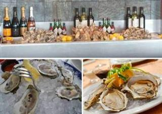 oyster bar with oysters on ice and wine