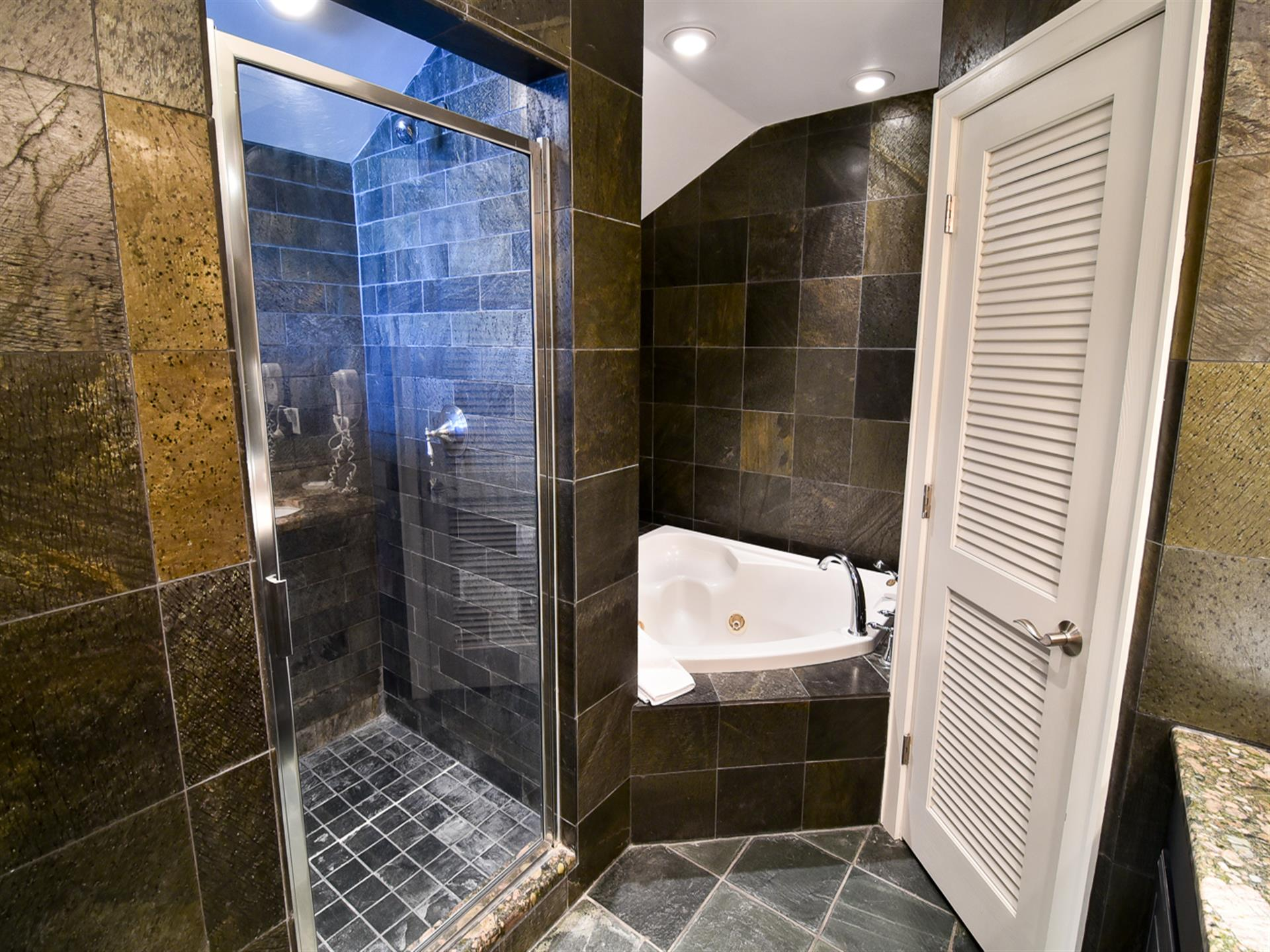 master bathroom with a shower and tub