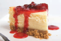 A piece of cheesecake with strawberry sauce