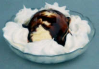 Vanilla ice cream served with chocolate syrup