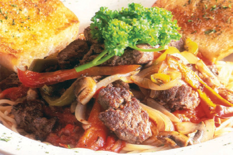 Buffalo meat diced up with grilled peppers, onions, mushrooms on top of sauce with spaghetti, served with garlic bread