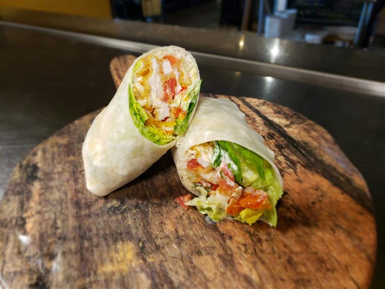 crispy chicken wrap with ranch dressing, tomatoes, and lettuce