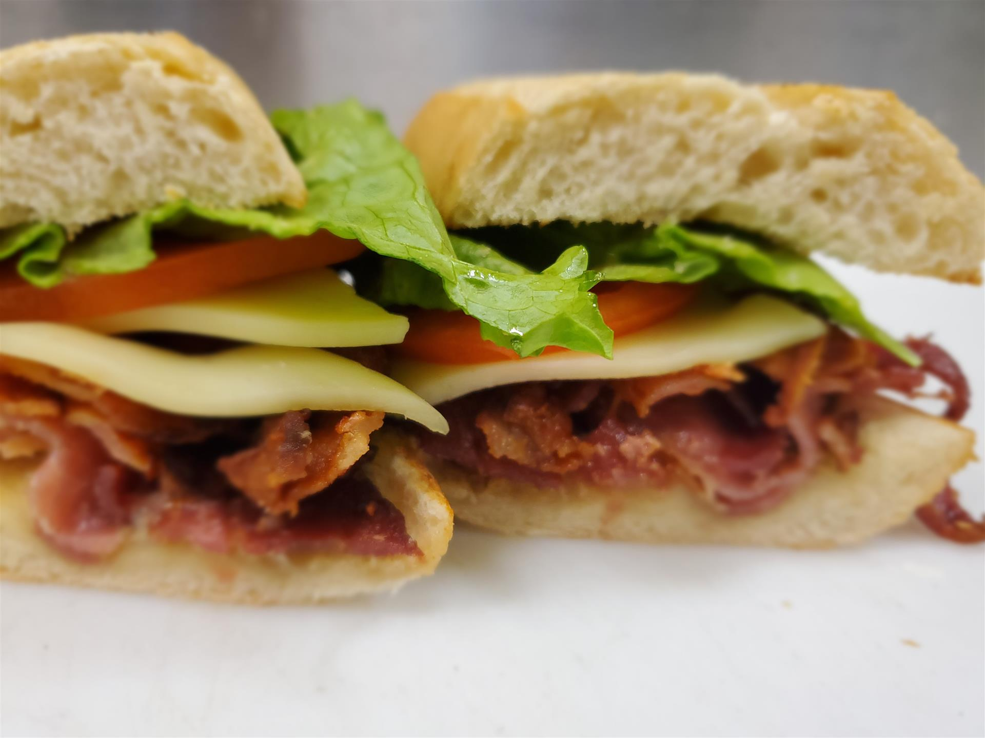 italian sub with lettuce, tomato and cheese