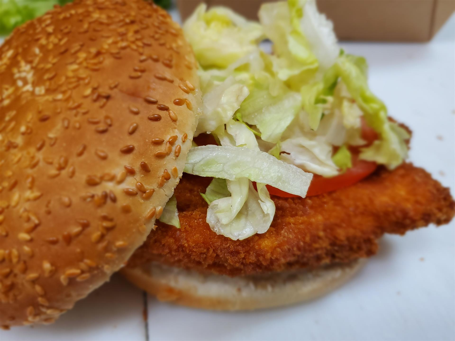 crispy chicken sandwich with shredded lettuce and tomato