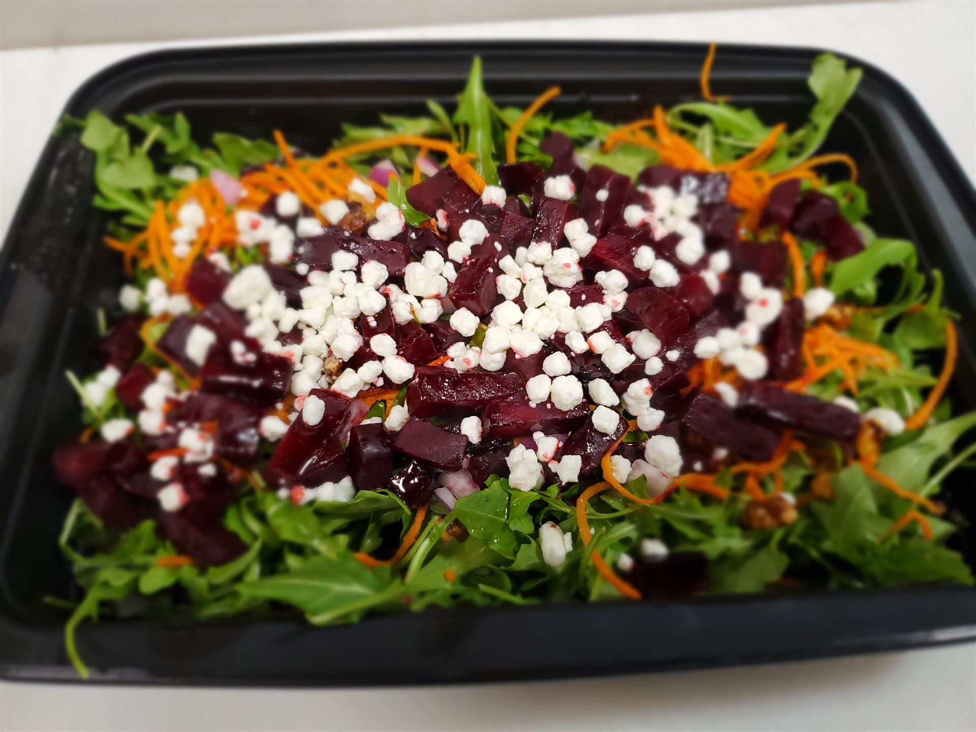 beet salad topped with goat cheese