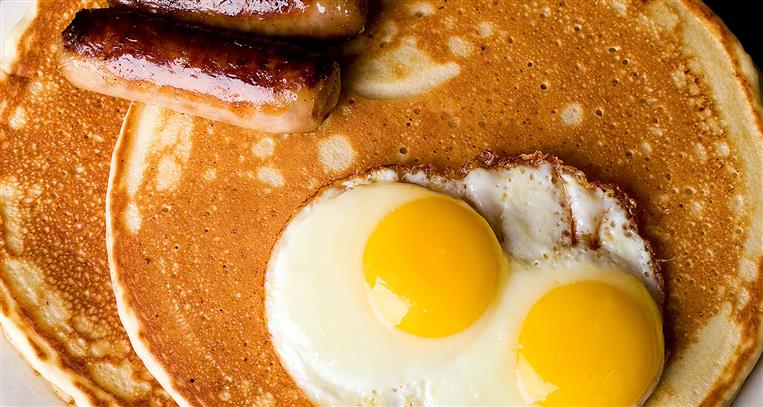 eggs, pancakes, and sausage