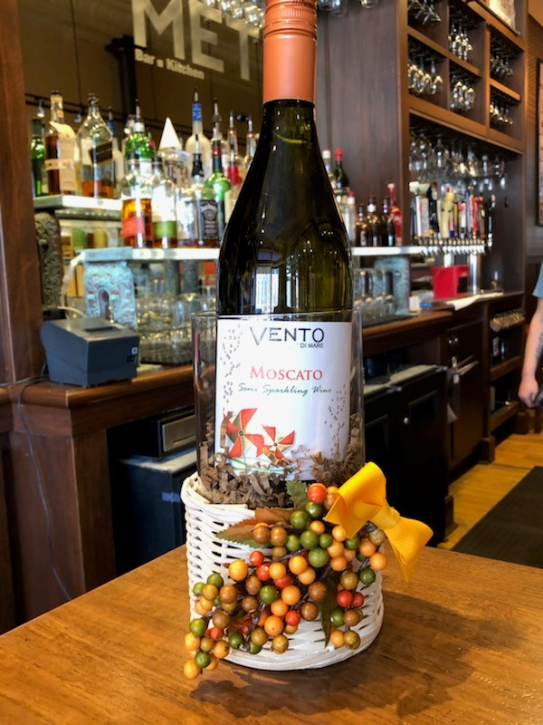 bottle of moscato wine in a decorated basket