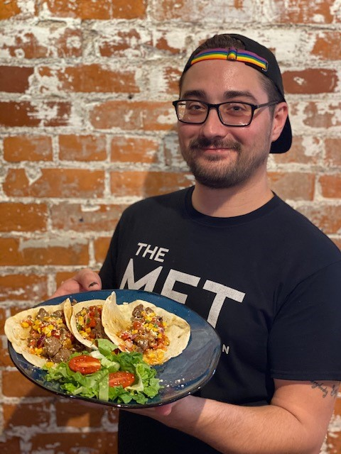 staff member holding plate of food