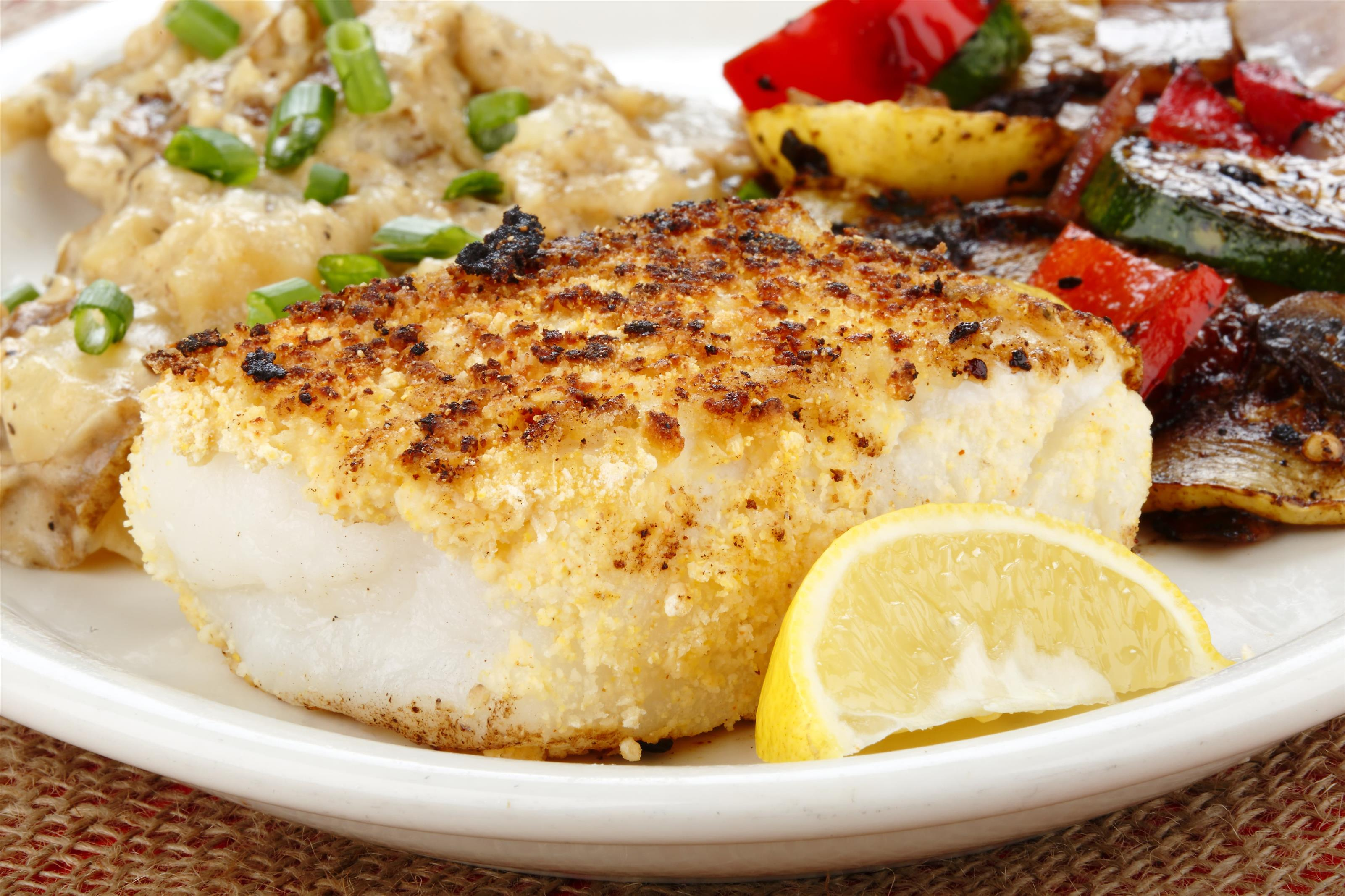 Sea bass filet with potatoes and grilled vegetables
