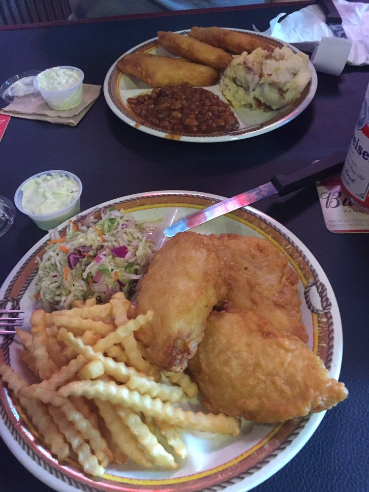plate of fried chicken with coleslaw and french fries