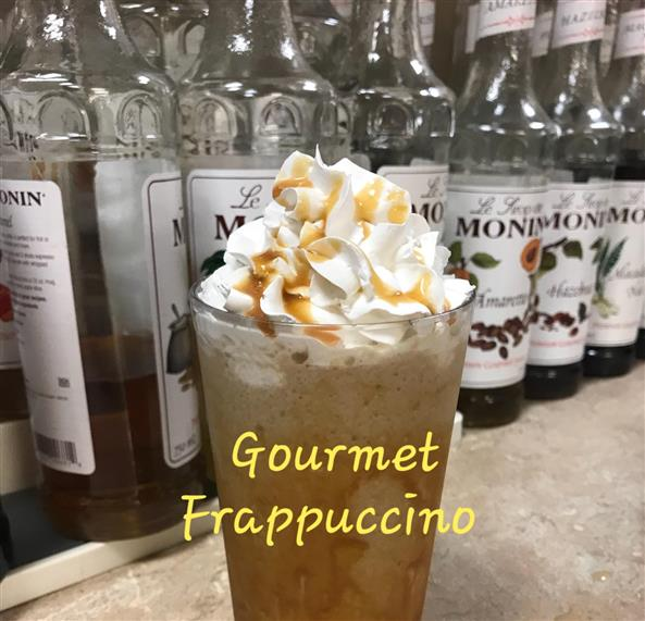 Frappe with whipped cream and caramel drizzle