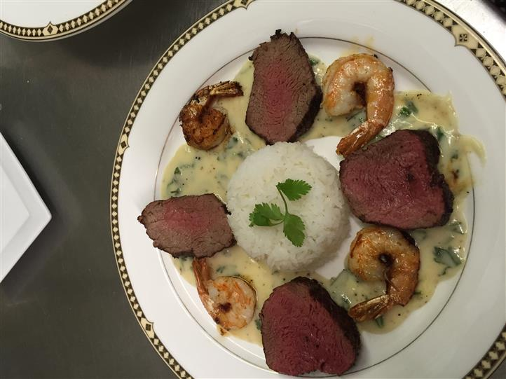 Steak and shrimp on a platter with rice