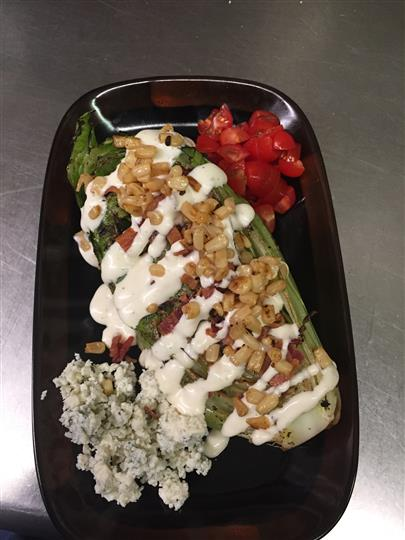 Vegetable dish topped with sauce