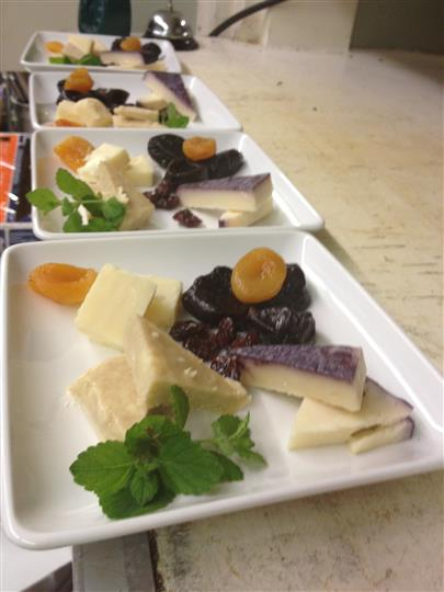 Cheese and raisins on a platter