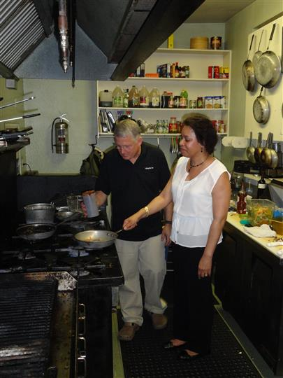 People in the kitchen cooking