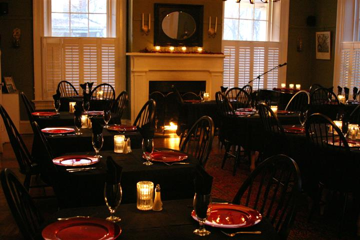 Dining area with fire place in the background