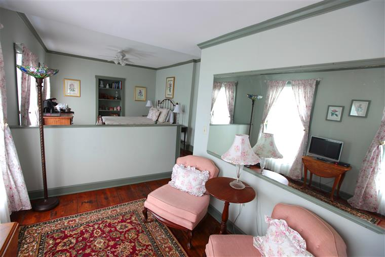Wilson Suite, chairs, bed, mirror