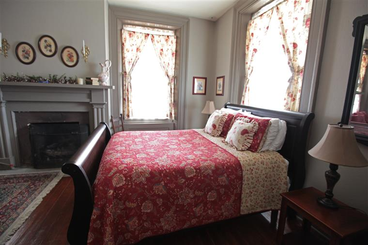 Bed on sleigh bed frame, fireplace