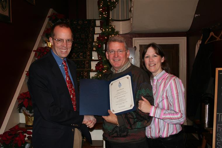 Inn Keepers Kaye and Alan receiving award inside the inn