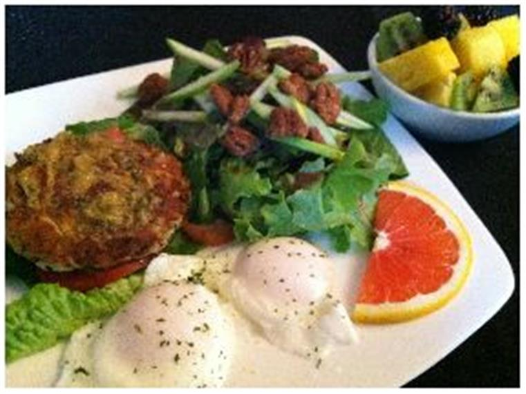 Crab cake with two eggs, walnut salad, slice of grapefruit