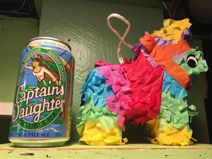Can of captains daughter double I P A next to donkey pinata.
