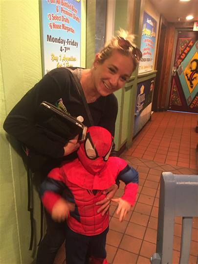 a woman and her son dressed as spiderman